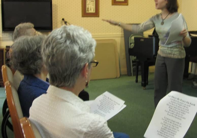 Our resident chorus (The Meadowlarks) practice in the living room